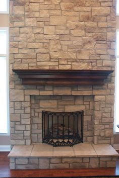 Ledge Stone Fireplace installed over drywall with a Spruce Beam ...