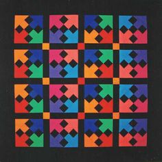 Arrows by Margaret Rolfe. This quilt is an original design based on traditional patterns found in Palestinian embroidery.