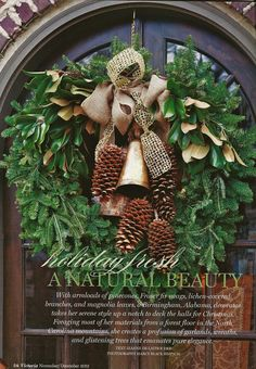 basic wreath with added with magnolia, pine cones and burlap/satin bows
