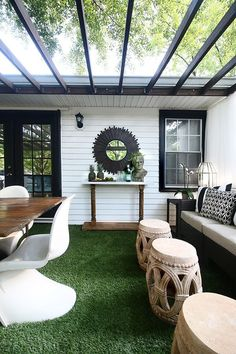 A backyard deck with a DIY console table, an outdoor furniture set and artificial grass