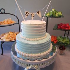 Double layer white cake for baby boy shower. Wedding cake flavor. Buttercream frosting. Cakes By Gigi.