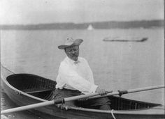 Roosevelt seated in a canoe holding oar on Sept. 11, 1905