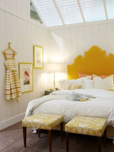 Mustard dot headboard, coral patterned pillows.