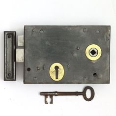 A good solid Victorian brass trimmed iron and steel rimlock. The case constructed from cast iron and steel and the bolt and latch of hand folded wrought iron. Fully restored and working and supplied with a period iron key and a reclaimed steel replacement keep.