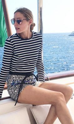 Who made  Olivia Palermo's white stripe shirt and black sunglasses?