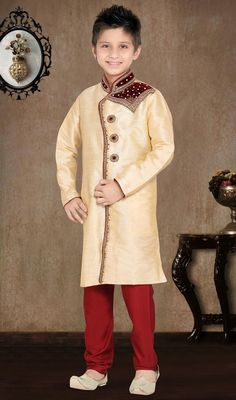 Beige shade art silk and raw silk sherwani featuring stones, zardosi and beads fully ornated collar, shoulder patch and front panel ameliorates the look. #IndianTraditionalStyleKurtaShervani