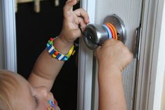 Rubberbands on doorknob... fun activity for a toddler. Now puts rubber bands on stuffed animals.