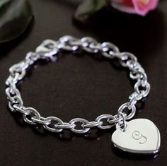 Of course, if your bridesmaids love jewelry, you could always get them each a bracelet. This one comes with a personalized charm. Get one for each bridesmaid with their first initial on the heart. | Personalized Charm Bracelets | 5 Bridesmaid Gifts for Jewelry-Lovers | My Wedding Favors