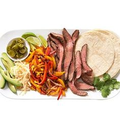 One secret to flat abs is a healthy dinner. Try these low-fat steak and pepper tacos that will make you forget you're on a diet.