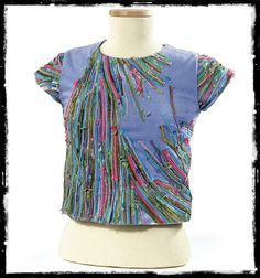 Love this! Sew yarn, or ribbon, to a shirt... or bag to create this look!