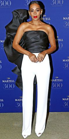 Last Night's Look: Love It or Leave It? | SOLANGE KNOWLES | in a black and white Stephane Rolland jumpsuit with a ruffle cape-like design at the Martell 300th Anniversary event in Versailles, France.