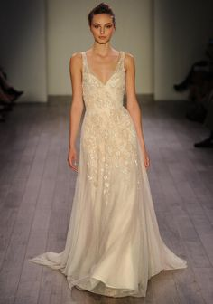 Jim Hjelm champagne wedding dress with beading and lace from Fall 2016 | https://www.theknot.com/content/jim-hjelm-wedding-dresses-bridal-fashion-week-fall-2016