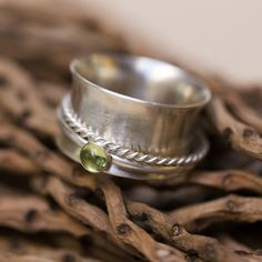 Handmade sterling silver & peridot spinner ring, made by Rebecca Cordingley…