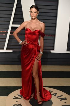 ALESSANDRA AMBROSIO changes from her pink Elton John party dress into a scarlet satin off-the-shoulder number with a high slit plus huge Bulgari emerald-and-diamond danglers and LoriBlu heels for the Vanity Fair afterparty. Red Carpet Dresses, Satin Dresses, Strapless Dress Formal, Alessandra Ambrosio, Evening Dresses, Prom Dresses, Formal Dresses, Beautiful Dresses, Nice Dresses