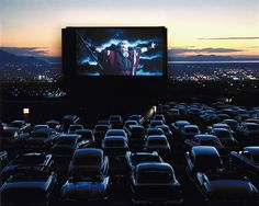 On the screen of a drive-in theater in Utah, Charlton Heston, as Moses in the The Ten Commandments, throws his arms wide before what appears to be a congregation of cars at prayer. Originally published in the December 22, 1958, issue of LIFE. See more: http://ti.me/HpxX39 (J.R. Eyerman—Time & Life Pictures/Getty Images)