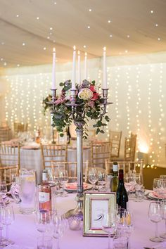 Blush Marquee Reception with Fairy Lights & Candelabra Centrepiece - Jo Hastings Photography | Romantic Blush Pink Wedding at Iscoyd Park in Shropshire | Pronovias Bridal Gown | Debenhams Bridesmaid Dresses | Hugo Boss Suit