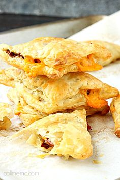 Bacon Cheddar Croissant Turnovers, a simple recipe perfect for entertaining. Fill puff pastry with smokey bacon and creamy cheese and bake until golden.