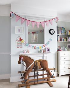 Children's Bedroom with Pale Blue Walls and Rocking Horse