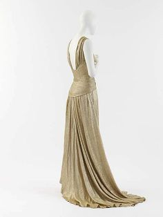 """Dress, Evening  House of Chanel (French, founded 1913)  Designer: Gabrielle """"Coco"""" Chanel (French, Saumur 1883–1971 Paris) Date: 1934 Culture: French Medium: silk, metal Dimensions: Length at CB: 93 1/2 in. (237.5 cm) Credit Line: Gift of Mlle. Gabrielle Chanel, 1955"""