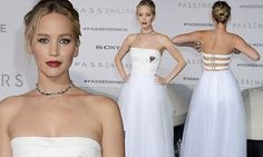 The 26-year-old put on a sophisticated show in a full-length strapless white gown with her blonde hair styled into an updo with several loose tendrils.