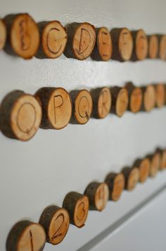 Wooden alphabet and number magnets ~ Simple and so frugal.  Use a fallen tree from your backyard.