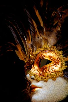 A feather mohawk!  Love the crackle effect on this Venetian Mask that makes it look beautifully aged.