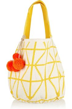 A woven cotton tote is perfect to hold your beach-day essentials and looks just as chic away from the shore. Sophie Anderson bag, $640, netaporter.com.