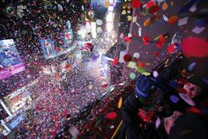 Confetti is dropped on revelers at midnight during New Year celebrations in Times Square in New York.