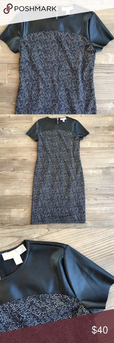 """Michael Kors Dress Michael Kors short sleeve dress with vegan leather at the top. The dress is a stretch material and does have a full lining. Size 4 - armpit to armpit 17"""" And armpit to hem is 28"""" - no stains or holes. Perfect condition. No trades. See closet rules on offers. No PP. Smoke free home. Please ask questions previous to buying! I'm a 5🌟 Seller & Fast 📦💌📪 Michael Kors Dresses Midi"""
