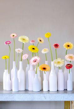 colorful gerbera daisies in milk glass vases Fresh Flowers, Beautiful Flowers, Happy Flowers, Decoration Evenementielle, Wedding Decorations, Table Decorations, Party Centerpieces, Deco Floral, Bottle Crafts