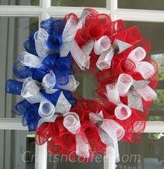 Fun & festive wreath made with Deco Mesh. Tutorial on CraftsnCoffee.com.