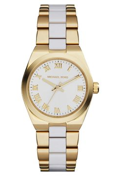 Pretty Michael Kors watch in white and gold.