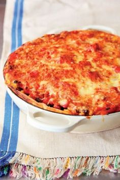 Yummy veggy mexican lasagne.  NB. The sauce can be made in the slow cooker