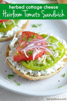 Toasted bagel is topped with an herbed cottage cheese, heirloom tomatoes, and Parmesan for a perfectly light breakfast or mid-morning snack.