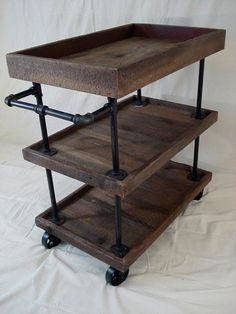 Three-tier, rustic, retro-style utility cart, made from rough-cut cedar and iron pipes and fittings. The cart is fitted with iron castor wheels for functionality and style. Your choice of gun-meal… Furniture Projects, Wood Projects, Furniture Design, Luxury Furniture, Wood Furniture, Modern Furniture, Furniture Websites, Furniture Dolly, Furniture Vintage