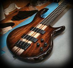 IC4W Icon series bass in figured claro walnut with maple walnut stripes! — at Kiesel Guitars Carvin Guitars.