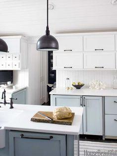 Pretty palette and finishes. Design: Lynn Butler Beling. Hidden appliances.