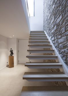 : Exquisite Floating STaircase Design At Hallway With Wooden Steps And Exposed Stone Wall At Casa OV Residence Decorated With Artwork Home Stairs Design, Interior Stairs, House Design, Design Hotel, Restaurant Design, Cantilever Stairs, Escalier Design, Industrial Stairs, Floating Staircase