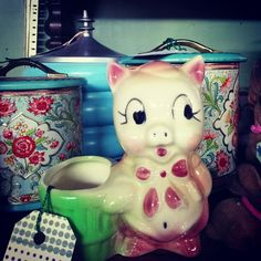 Vintage pig and tins