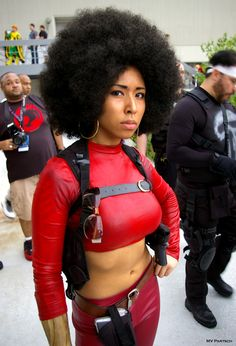 americancomicon:     Misty Knight: Detective for Hire!     Dragon*Con. Atlanta. 2013. The Atlanta Hilton: Patio Courtyard Exterior.     70's-Play by Cosplay Ninja Assassin *Socies M. Wilson*!!