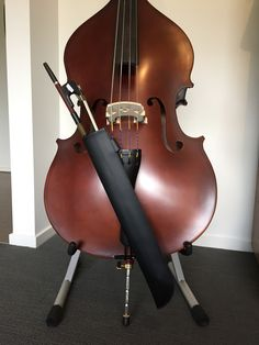 Double Bass bow quiver made from a child's plastic archery quiver attached to E string just above the tailpiece. The quiver rests against the tailpiece itself so shouldn't cause any rattles when playing.....we'll see!