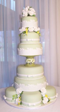 Copy_of_green_rose_tiers_4.jpg - Green fondant cake with white fondant lace.  Handmade gumpaste roses and accent flowers.