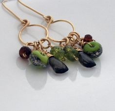 """Smoky quartz, citrine, peridot, and my own artglass beads are suspended from 14kt yellow gold fill rings. Earrings measure approximately 2""""."""