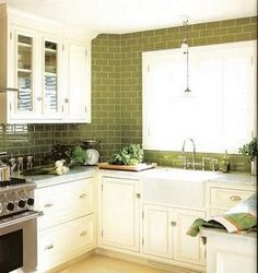 green glass subway tile and white cabinet