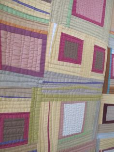 Liberated Log Cabin with Applique Borders by Gwen Marston