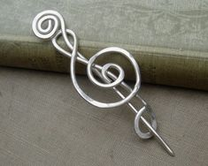 I think this would spend a lot of time in my hair... or keeping a handknit shawl or sweater closed...