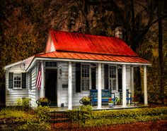 Tiny Cottage, love the red tin roof.