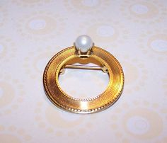 I had a circle pin like this...they were also popular in high school in the 1960's.