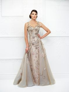 83f023784e5 Ivonne D by Mon Cheri Decadent metallic lace adorns this amazing sleeveless  tulle A-line gown with hand-beading. An illusion bateau neckline with lace  ...