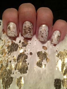 """Gold splatter nails! Got my inspiration from my new fauxfur white and gold scarf that I'm obsessed with currently. Matches pretty well I think! Colors- Ulta-""""snow white"""" and Essie mirror metallics """"-good as gold"""""""